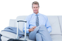 Elegant businessman with laptop sitting on sofa at home Royalty Free Stock Images