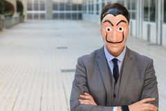 Elegant businessman with a mask royalty free stock photography