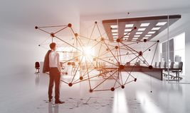 Networking and social communication concept as effective point for modern business. Elegant businessman in modern office interior and social connection concept Stock Image