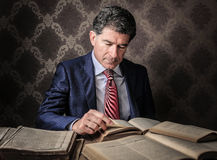 Elegant businessman reading some books Stock Image