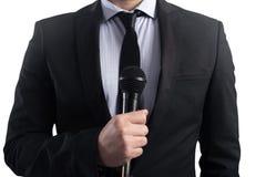 Elegant Businessman ready to speak with microphone stock photo