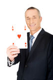 Elegant businessman with red ace card Royalty Free Stock Photography