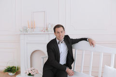 The elegant businessman in smoging with butterfly royalty free stock image
