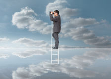 Elegant businessman standing on ladder with binoculars Royalty Free Stock Photo