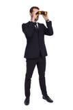 Elegant businessman standing and using binoculars Stock Photos
