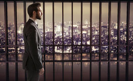 Elegant businessman on the top of the skyscraper Royalty Free Stock Image