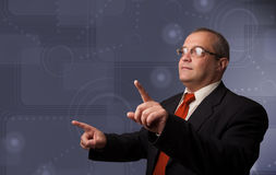 Elegant businessman touching copy space Royalty Free Stock Images
