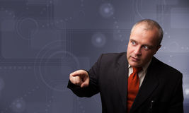 Elegant businessman touching copy space Royalty Free Stock Photo
