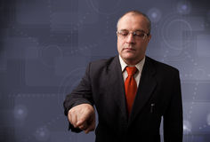 Elegant businessman touching copy space Stock Photo