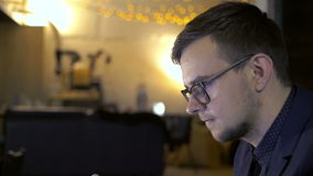Elegant businessman using smartphone on the fine background stock footage