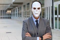 Elegant businessman wearing a horrible mask stock images