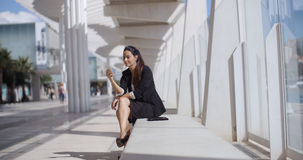 Elegant businesswoman checking her phone messages Royalty Free Stock Photos
