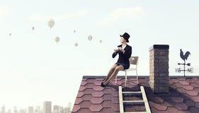 Elegant businesswoman in cylinder hat . Mixed media Stock Photo
