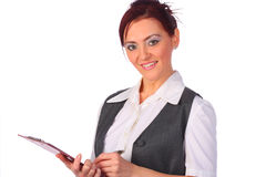 Elegant businesswoman holding a clipboard,isolated Royalty Free Stock Images