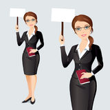 Elegant businesswoman holding a poster with space for your text or product. Smiling businesswoman in black suit holding white broadsheet ready for your text or Stock Photo