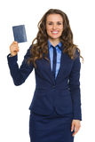 Elegant businesswoman holding up passport and smiling Stock Photos