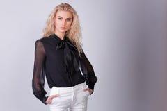 Elegant businesswoman isolated on gray background Royalty Free Stock Photos