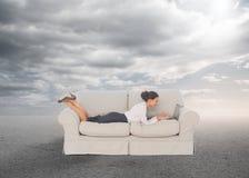 Elegant businesswoman lying on couch Stock Photo