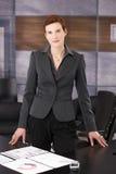 Elegant businesswoman in office Stock Photos