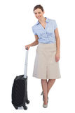 Elegant businesswoman posing with suitcase Royalty Free Stock Photography