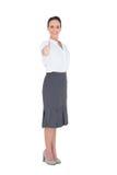Elegant businesswoman posing thumb up Royalty Free Stock Photos