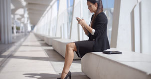 Elegant businesswoman reading her text messages Royalty Free Stock Images