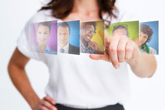 Elegant businesswoman selecting future employees. On digital interfaces Stock Image