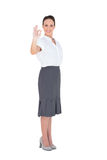 Elegant businesswoman showing an okay gesture Stock Photo