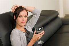 Elegant businesswoman sit leather sofa drink wine Royalty Free Stock Photo