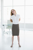 Elegant businesswoman suffering from back ache in office Stock Photos