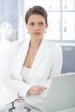 Elegant businesswoman using laptop Stock Images