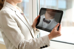 Elegant businesswoman using tablet PC in a bright office  near with window Stock Photo
