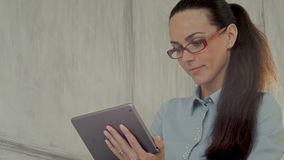 Elegant businesswoman using tablet PC in a bright stock video footage