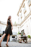 Businesswoman legs walking to meeting. Elegant businesswoman walking to a meeting in a luxury building coffee shop terrace, outdoors Stock Photos