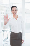 Elegant businesswoman waving hand in office Stock Photos
