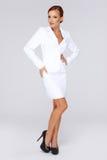 Elegant businesswoman in a white suit Stock Photo