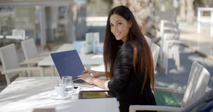 Elegant businesswoman working on a laptop Stock Image