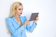 Elegant businesswomen in white jacket and red lips Stock Image