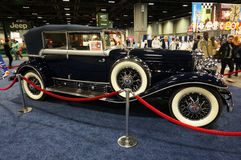 Elegant Cadillac Phaeton. Photo of 1931 vintage cadillac phaeton luxury car at the washington dc auto show on 1/28/16.  This car features elegant styling and a Royalty Free Stock Photos