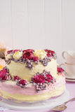 Elegant cake decorated with burgundy cream rose flowers Royalty Free Stock Images