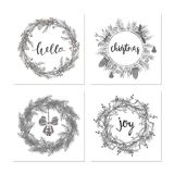 Cute hipster wreaths. Elegant calligraphic lettering phrases with wreaths. big collection of hand written christmas phrases and quotes Stock Photography