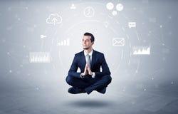 Businessman levitates with data circulation concept. Elegant calm businessman levitates in yoga position with data circulation concept Stock Photos