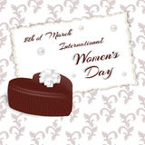 Elegant card with white chocolates in heart-shaped and marked International Women`s Day on 8 March. Vector stock illustration