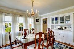 Elegant carved wood dining table set Stock Image