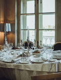 Elegant Catering Table Set Service with Silverware, Napkin and G Royalty Free Stock Images