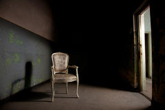 Elegant chair in grunge environment Stock Photography