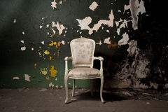 Elegant chair in grunge environment Stock Photos