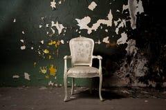 Elegant chair in grunge environment Stock Photos