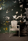 Elegant chair in grunge environment Royalty Free Stock Images