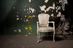 Elegant chair in grunge environment Stock Image